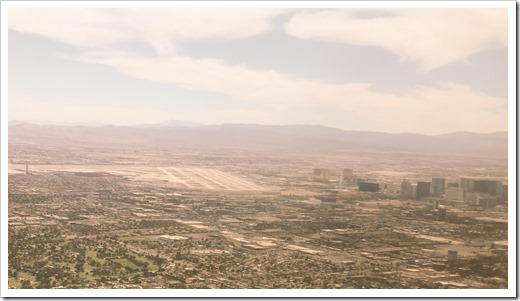 Final Descent into Las Vegas McCarran airport, with the strip already beckoning (click for larger photo)